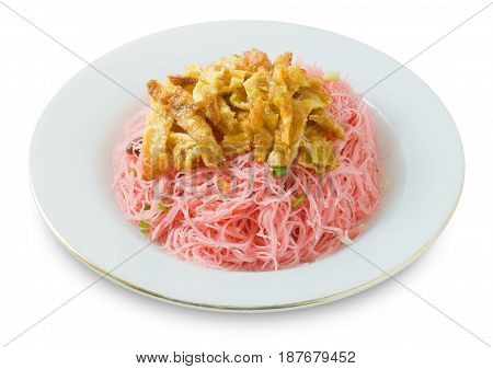Thai Cuisine and Food A Dish of Red Stir Fried Rice Vermicelli Topping with Julienne Omelet.