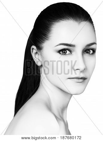 Portrait of beautiful young woman over white background.