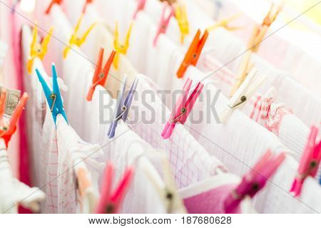 Colorful Clothespin With Kitchen Towels Outside