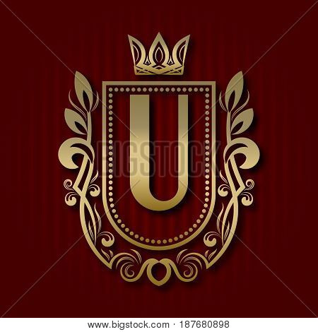 Golden royal coat of arms in medieval style. Vintage logo with U monogram.