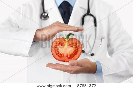 Healthy food and natural nutrition medical diet concept hands doctor with tomato