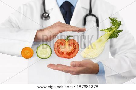 Healthy food and natural nutrition medical diet concept hands doctor with vegetables