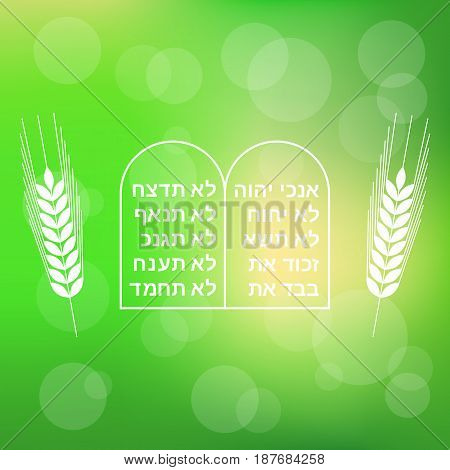 Ten commandment with barley on bokeh background for Shavuot festival