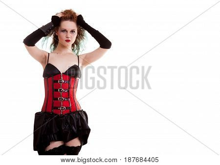 BDSM model in leather corset posing on white background in studio photo