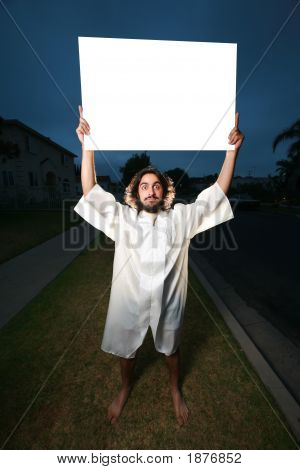 Crazy Man With Blank Billboard Sign On A Street At Night