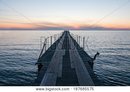 Vacation and Holiday concept - Wooden pier between sunset.
