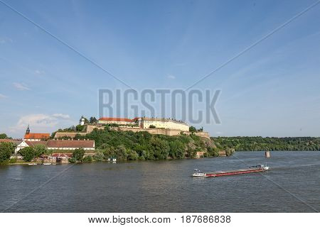 Barge passing in front of Petrovaradin fortress in Novi Sad Serbia. This castle is one of the symbols of Serbia Danube river is the main axis of navigation in Europe