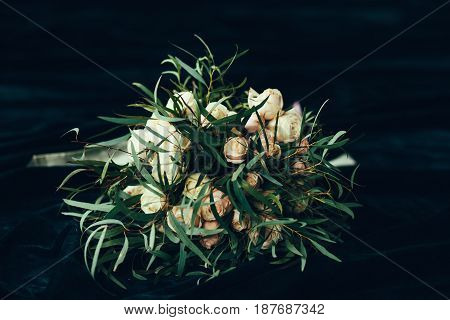 beautiful modern wedding bouquet on dark background
