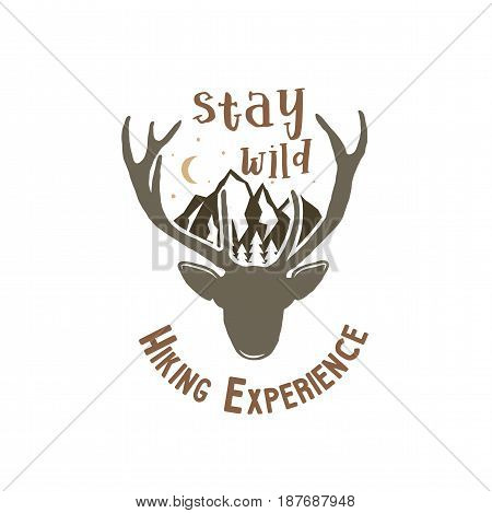 Hand drawn vintage camping badge and hiking label with wild animals design elements. Included deer head, mountains and quote text- stay wild . Old style patch. Rustic stamp stock vector template.