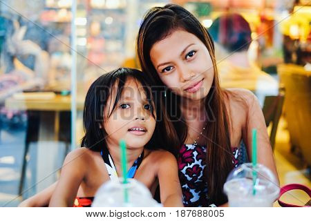 Happy Bonding Of Two Sisters In A Cafe