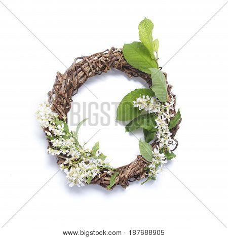 Floral frame on a white background. Bird cherry flowers wreath