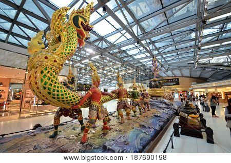BANGKOK THAILAND- MAY 16 2017: Traditional Thai dragon and dancers statue in the departues area of Suvarnabhumi Airport Bangkok Thailand