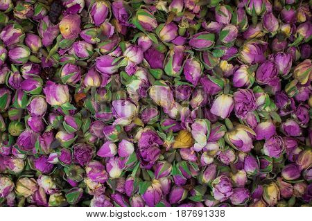 Dry tea rose buds on the market. Top view