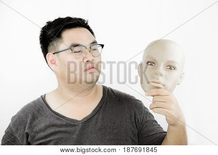 a guy holding plastic smart face mask, surgery, dieting concept
