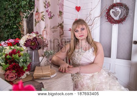 Young pregnant bride posing for the camera