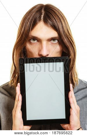 Elegant handsome man holding tablet computer with blank screen showing copyspace. Young guy advertising new modern technology.