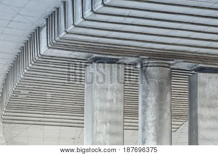 large supporting beams made of concrete and poles of a flyover highway