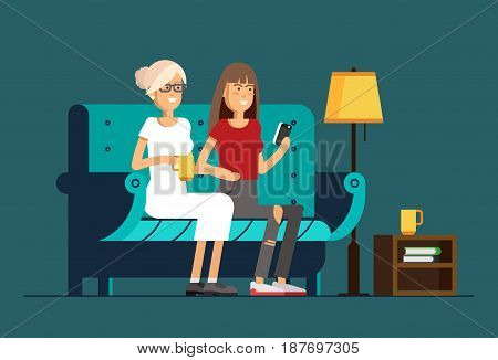 Couple girl with smart phone chatting and sitting in cozy armchair with a cup of hot tea or coffee. Friends relationship.