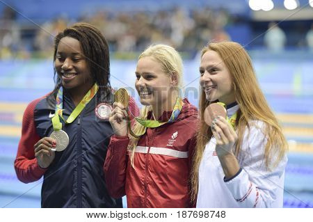 Rio de Janeiro Brazil - august 13 2016: Simone Manuel (L) (USA) Pernille Blume (DEN) (C) and Aliaksandra Herasimenia (R) (BLR) during medal ceremony after Women's 50 metre freestyle of the Rio 2016 Olympics