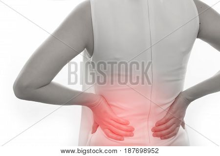 young woman having Low and Lower Back Pain on isolated white background.