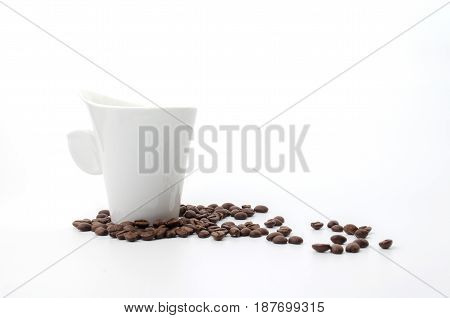 coffee beans and white coffee cup isolated on white background