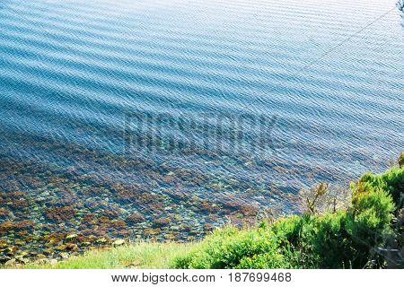 Swell on water in sea or ocean. Little waves ans shore