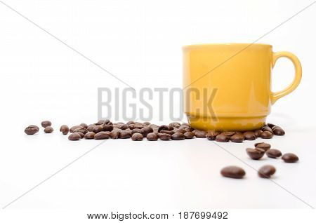 coffee beans and yellow coffee cup isolated on white background
