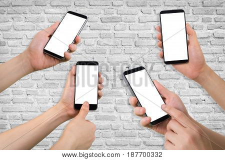 group of human hand hold smartphone tablet cell phone on white brick wall texture background.