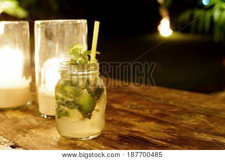 Mojito cocktail glass of lemonade on wooden table