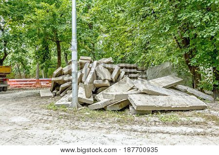 View on piles of concrete slabs in the park background.