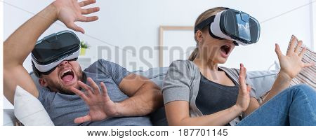 Frightened Couple With Vr Glasses