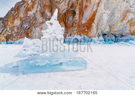 Ice blocks in front of rock island in Lake Baikal Russia