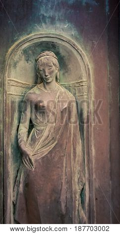 Female religious statue at a cathedral in  siena