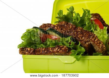Tasty Healthy Vegetarian Vegan Sandwich in Lunch Box on White Table Background. Horizontal. Copy Space. Closeup.