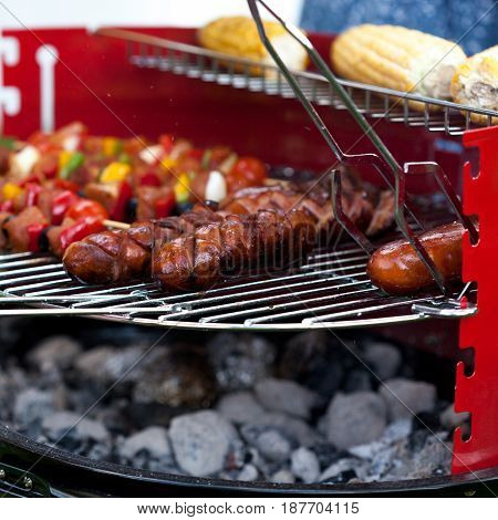 Sausages, Shiskebabs And Corns On The Grill