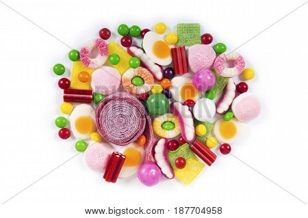 Colorful candies jelly and marmalade isolated on white background. Top view.