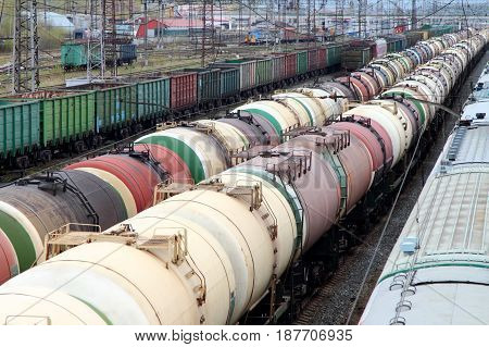 Tanks for liquid cargo stand on the railroad tracks.