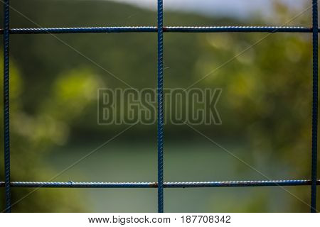 Blue improvised fence with a background of nature fence fittings