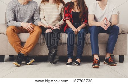 Casual young people legs crop, friendship, communication concept