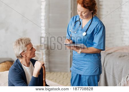 What bothers you. Qualified experienced capable doctor meeting her patient at home and hearing him out while he having some symptoms worrying him