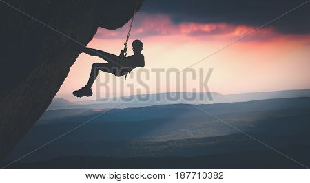 Climber On A Cliff Against Misty Mountains. Instagram Stylisation