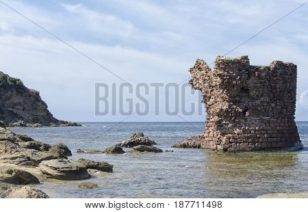 Ancient ruin of tower emerges from the sea