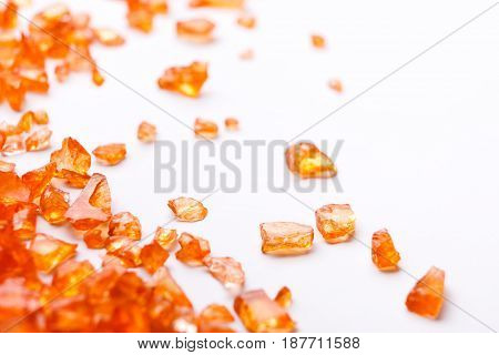 Orange Citrine gemstones on white background. Bright backdrop of natural jewels with free space for text, close up.