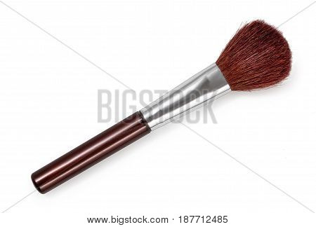 Cosmetic brush with natural fur for blush isolated on a white background. Top view close up.