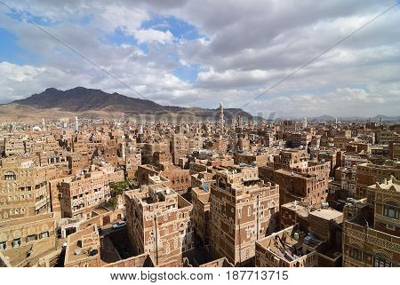 Traditional architecture n Sanaa Yemen. Inhabited for more than 2.500 years at an altitude of 2.200 m the Old City of Sanaa is a UNESCO World Heritage City