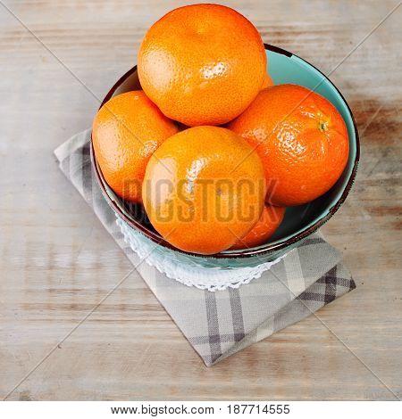 Fruit on Old Wooden Background. Ripe Mandarins