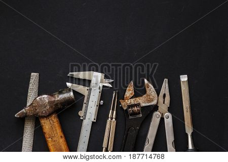 Working Tools On Black Background Top View. Set Instruments For Hand Work And Fixing. Construction A