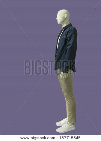 Full-length male mannequin dressed in jeans jacket and trousers. No brand names or copyright objects.