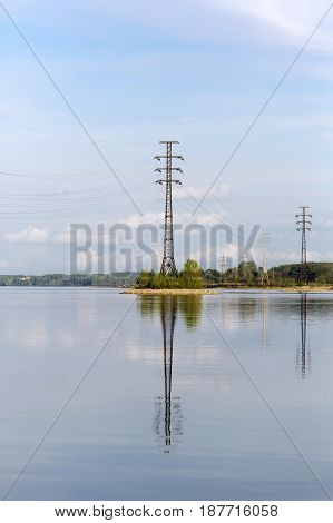 The supports of overhead power lines installed in the river. The river Berd Berdsk Novosibirsk oblast Siberia Russia