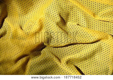 Sport Clothing Fabric Texture Background. Top View Of Yellow Polyester Nylon Cloth Textile Surface.